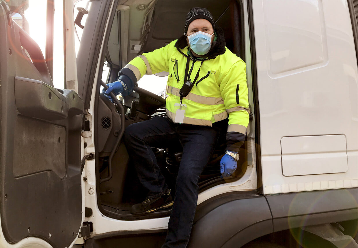 Truck driver wearing a mask to prevent covid-19 from spreading
